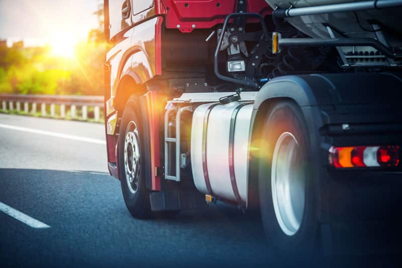 truck on freeway Tips for Selecting Safe Drivers for Your Business