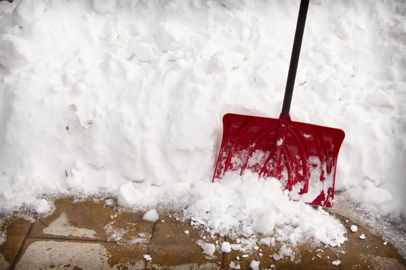 snow shovel next to snow