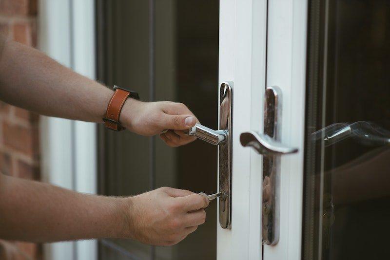 person locking a door