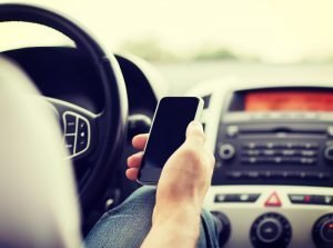 driver with phone in hand